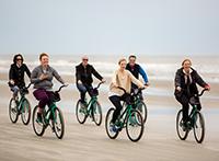 Biking down the beach